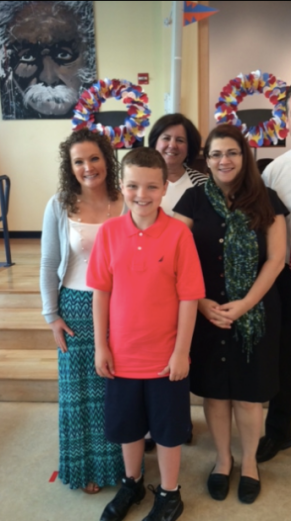 Thomas Brosnan with 5th grade teachers Mary Katherine Conceison and Memorial School Principal Deb Dressler